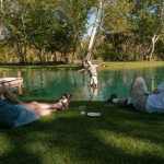 Relax under cottonwood trees around the lake.